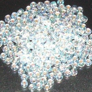 Rocalla Matsuno 12/0 silver irisado cristal. Bolsa